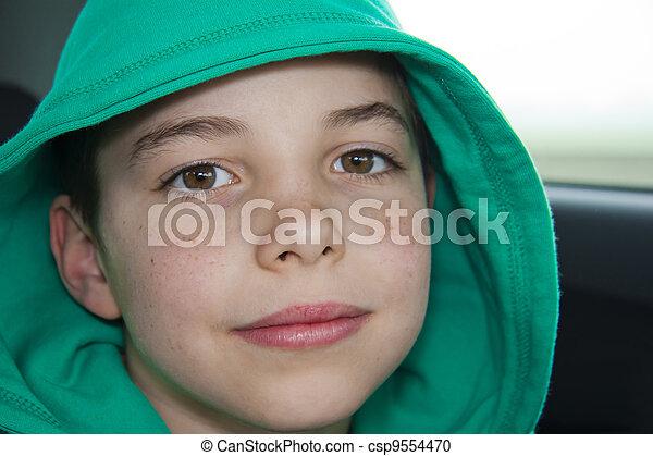 Stock Photo - closeup of cute young teen boy in green hood