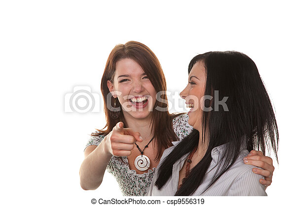 two young women burst into laughter - csp9556319
