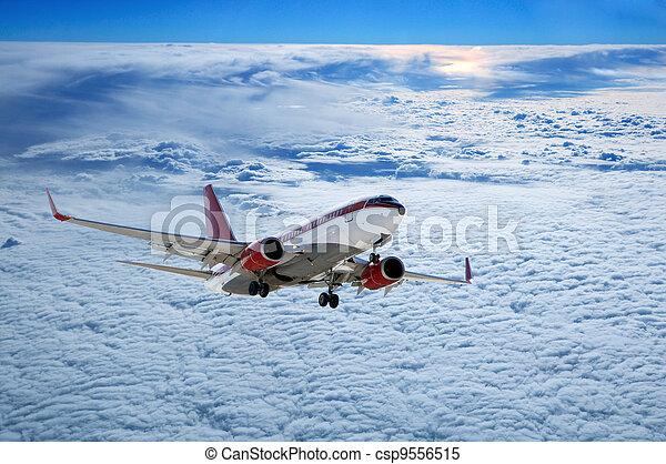 plane Above Sunset - csp9556515