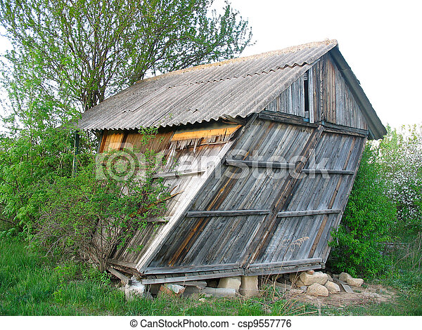 Abandoned old wooden small curved house - csp9557776