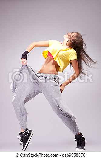 woman dancer in a full of energy dance pose
