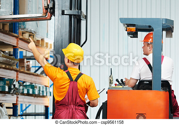 manual workers in warehouse - csp9561158