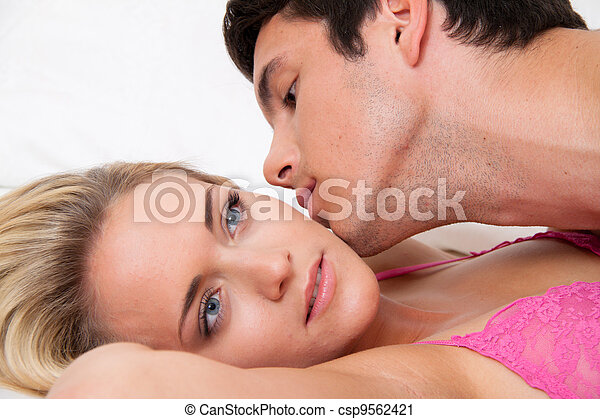 couple in bed during sex and affection. love and e - csp9562421