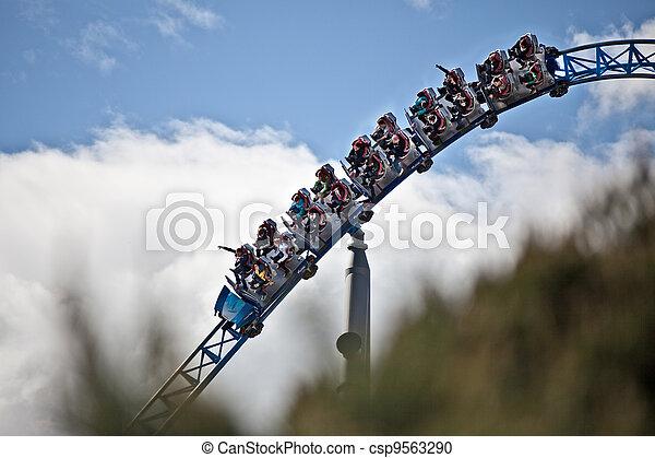 Rollercoaster drives through  - csp9563290