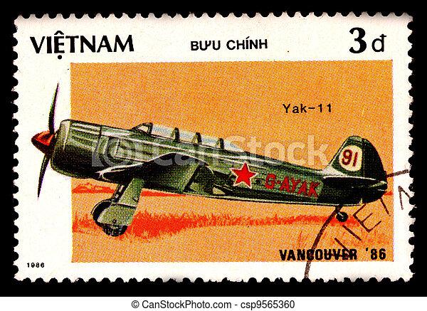 VIETNAM - CIRCA 1986: A stamp printed by VIETNAM shows military aircraft ( Yak-11 ) Circa 1986 - csp9565360