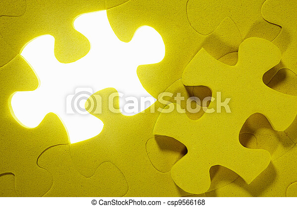 Conceptual shot with missing puzzle piece - csp9566168