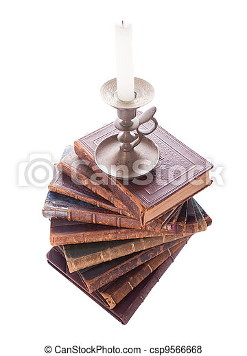 stack antique books and candlestick - csp9566668