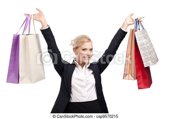 Young business woman in a black suit holding shopping bags - csp9570215