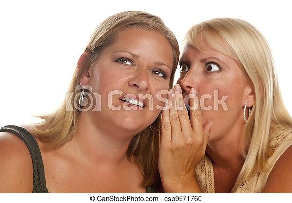 Two Blonde Woman Whispering Secrets - csp9571760