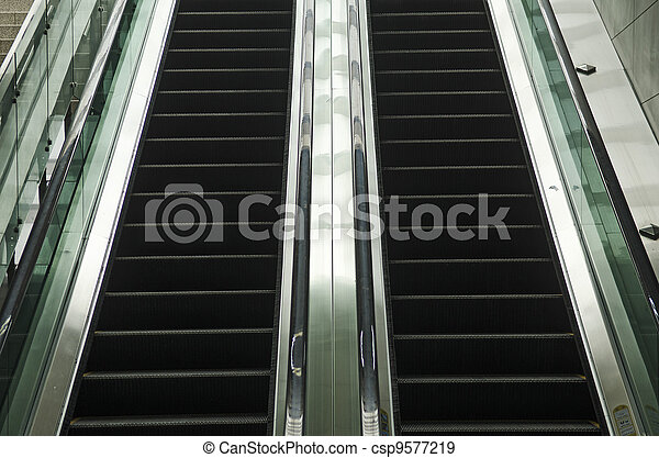 modern glass and metal escalator detail - csp9577219