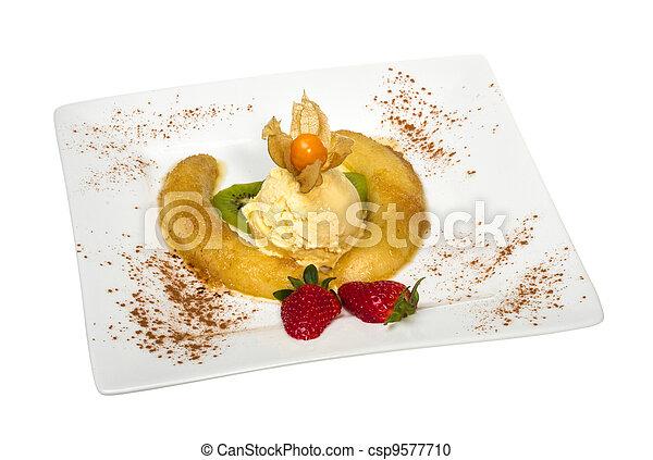 Dessert of banana, ice-cream, caramel, strawberry and mint - csp9577710