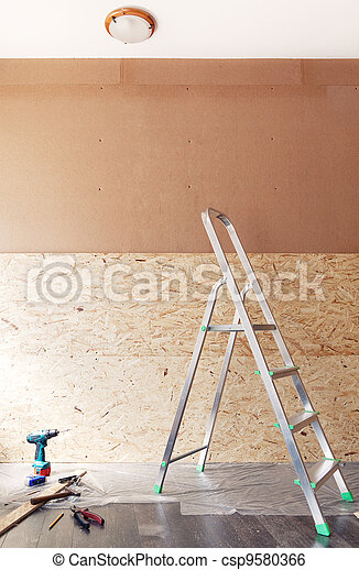 Work tools and ladder in front of new blank unfinished wall made of plywood - csp9580366