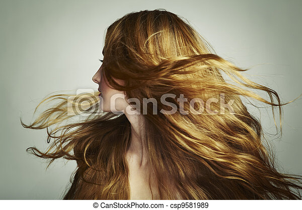 Portrait of young beautiful woman with long flowing hair - csp9581989