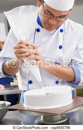 Decorating cake - csp9583796