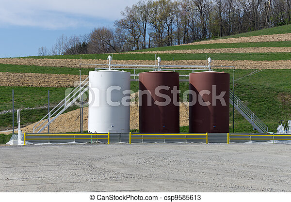 Storage tanks on a gas well site - csp9585613