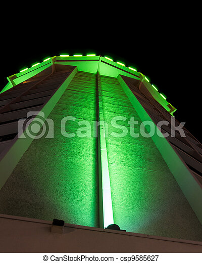 Apartment building lit by green lights - csp9585627