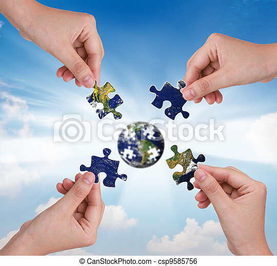 Business concept with a hand building puzzle globe - csp9585756
