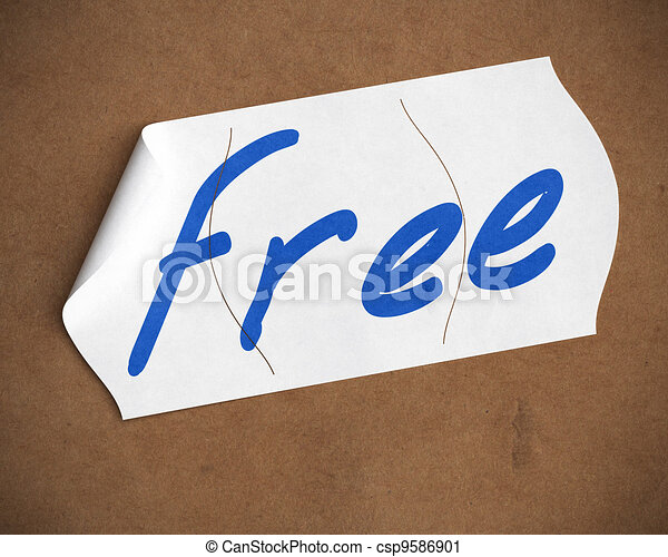 free word hanwritten onto a tearable price tag over a cardboard background, blue color text, white label and brown carton - csp9586901