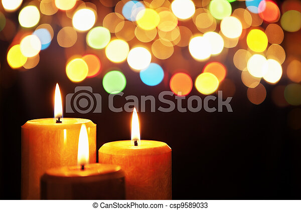Christmas candle with blurred light - csp9589033