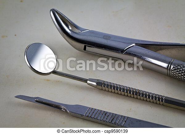 Dental tools on vintage background - csp9590139