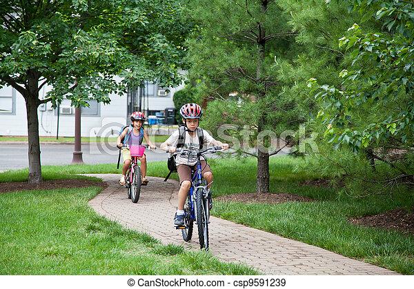 Kids Biking to School - csp9591239