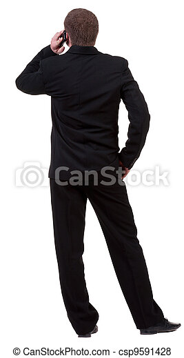 back  view of business man in black suit  talking on mobile phone. people collection. Rear view .  Isolated over white background. backside view of person.  - csp9591428