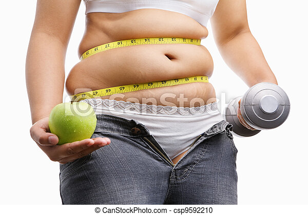 fat woman with unzup jeans holding apple and weight on each hand, id a concept to fight against obesity - csp9592210