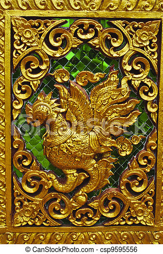 Animal carvings on the doors of the temple in the novel in a Tha