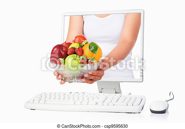 Female hand holding fruits coming out from computer screen - csp9595630