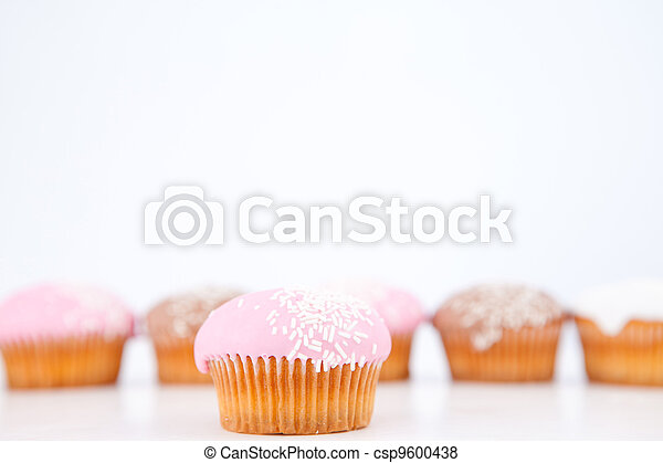 Many muffins with icing sugar lined up - csp9600438