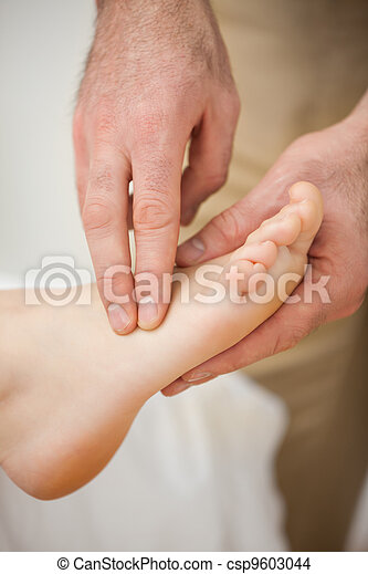 Two fingers palpating the muscles of a foot - csp9603044