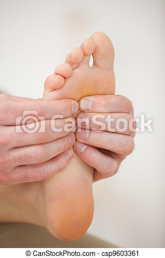 Barefoot being massaged by a physiotherapist - csp9603361