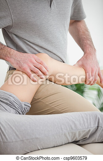 Leg of a patient being placed on the doctor - csp9603579