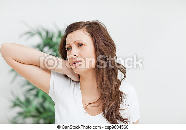 Woman placing her hand on her neck - csp9604560