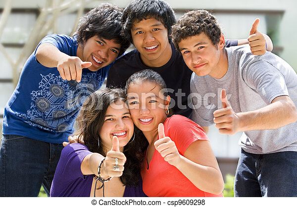 Teenagers posing outside school - csp9609298
