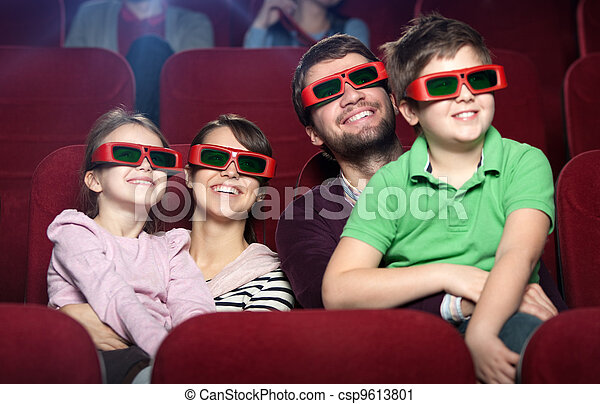 Smiling family in the movie theater - csp9613801