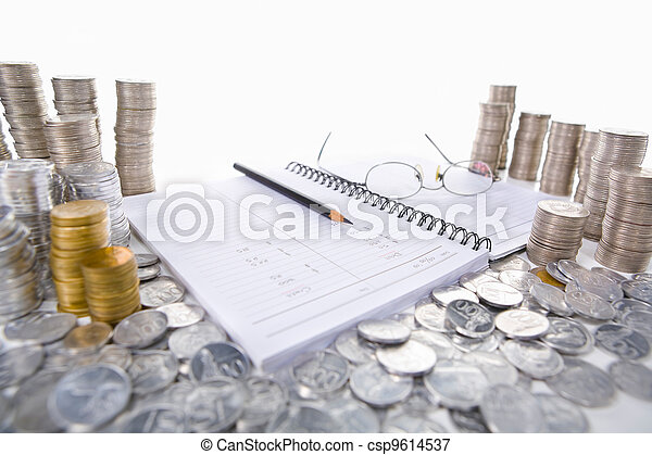Accounting ledger between piles of coins - csp9614537