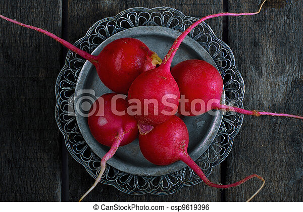 Radish on a metal plate - csp9619396