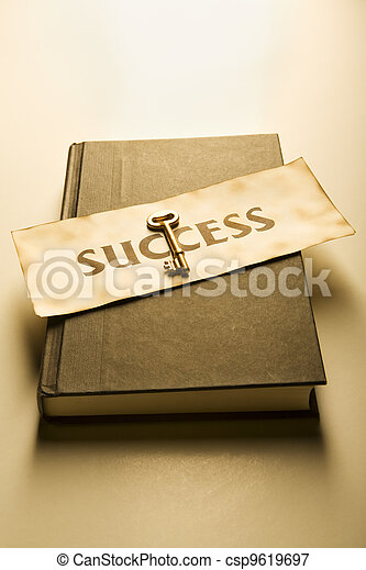 Book with golden key and success label (warm) - csp9619697