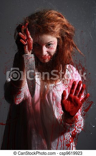Horror Themed Image With Bleeding Freightened Woman - csp9619923
