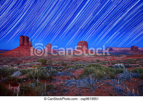Daylight and Star Trail Image of Monument Valley Arizona USA - csp9619951
