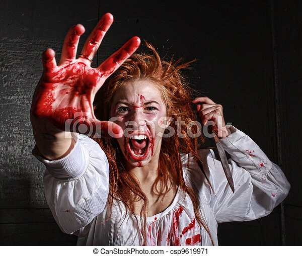 Horror Themed Image With Bleeding Freightened Woman - csp9619971