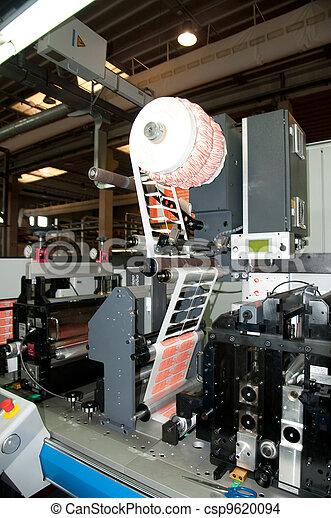 Stock Photo of Industrial printshop: Flexo press printing - Flexo press for...