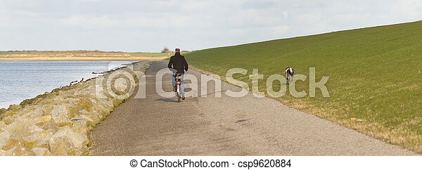 A cyclist with his dog - csp9620884