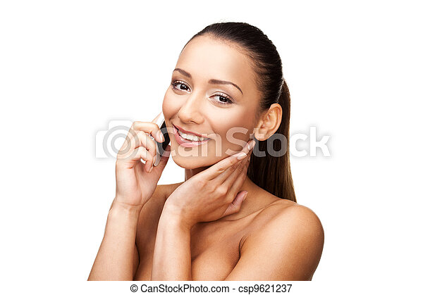 Woman with bare shoulders on her mobile - csp9621237