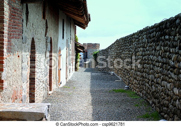 shady path in a medioeval stone made castle - csp9621781