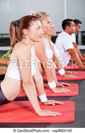 group of fitness people stretching  - csp9624143