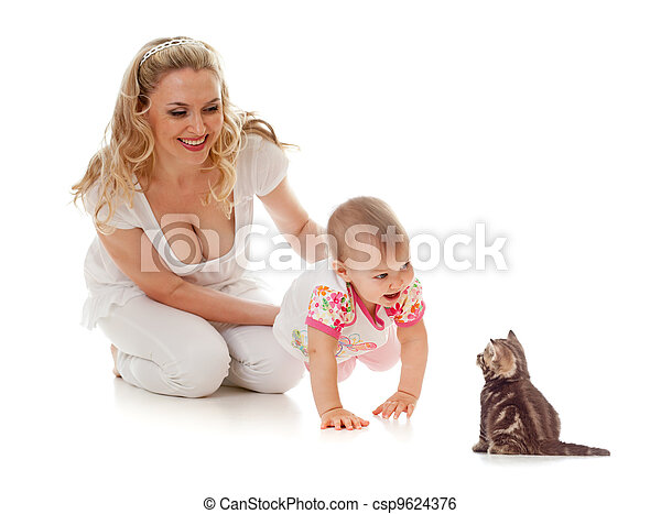 Kid and loving mother; girl steps on her hands forward to small kitten - csp9624376