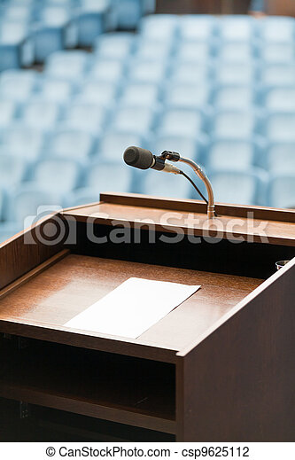 Speaker's table with paper, your text possible - csp9625112