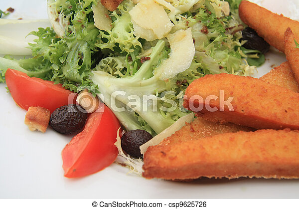 salad with fried chicken, goat cheese and tomato - csp9625726